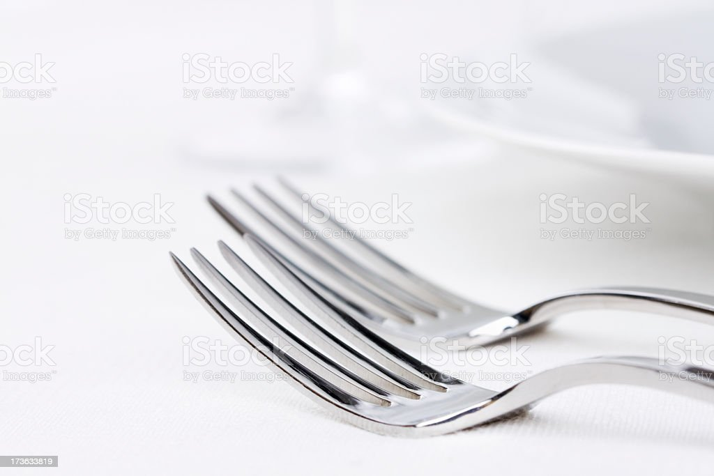 Two Forks, Silverware in White Place Setting with Plate, Glass royalty-free stock photo