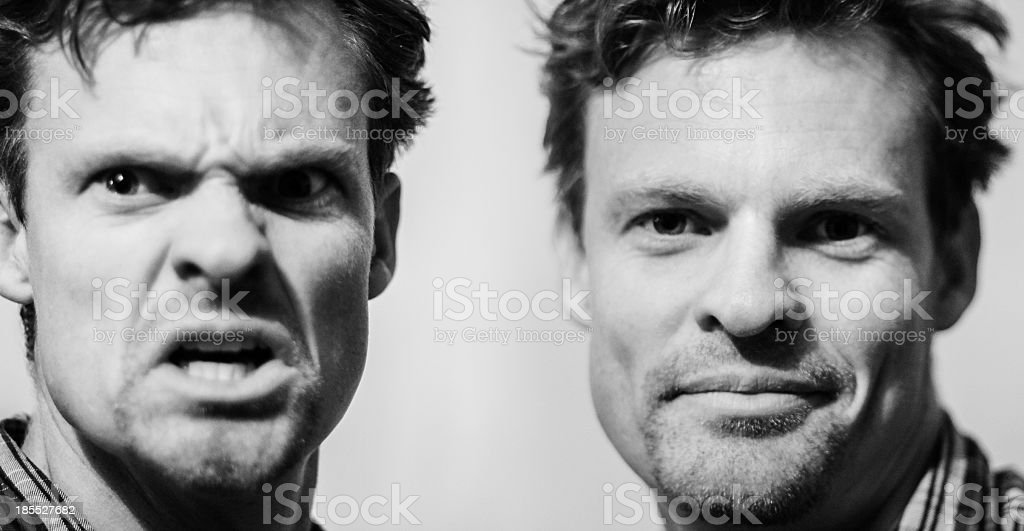 Two forms of a man with different emotions stock photo