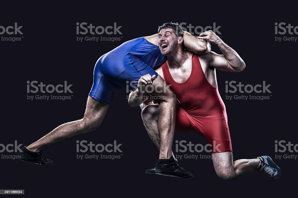 Two freestyle wrestlers in action stock photo