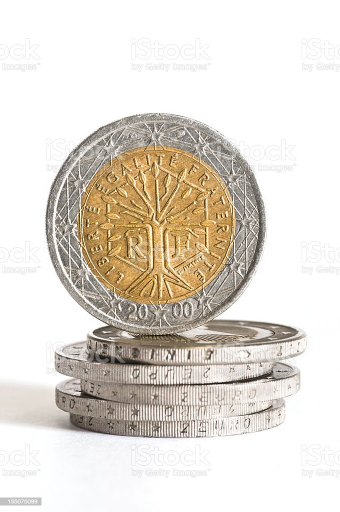 two french euro coin on stacks of euros stock photo