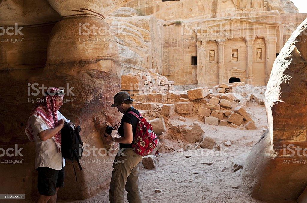 Tourists in the Middle East in Petra, Jordan stock photo
