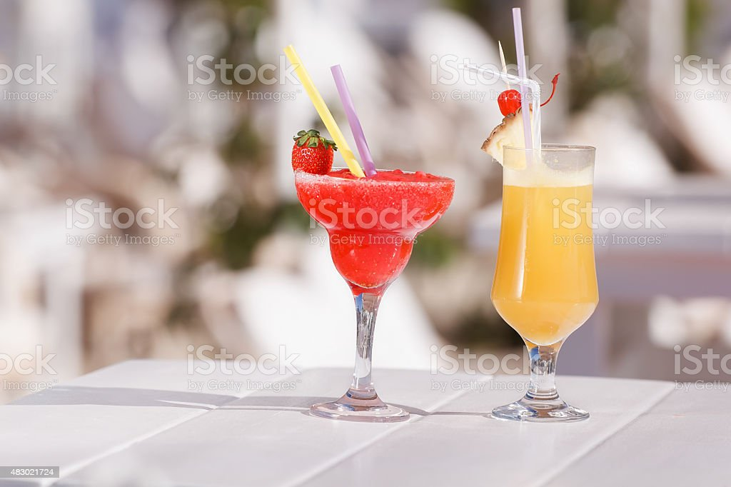 Two fresh cocktails on a bar table stock photo