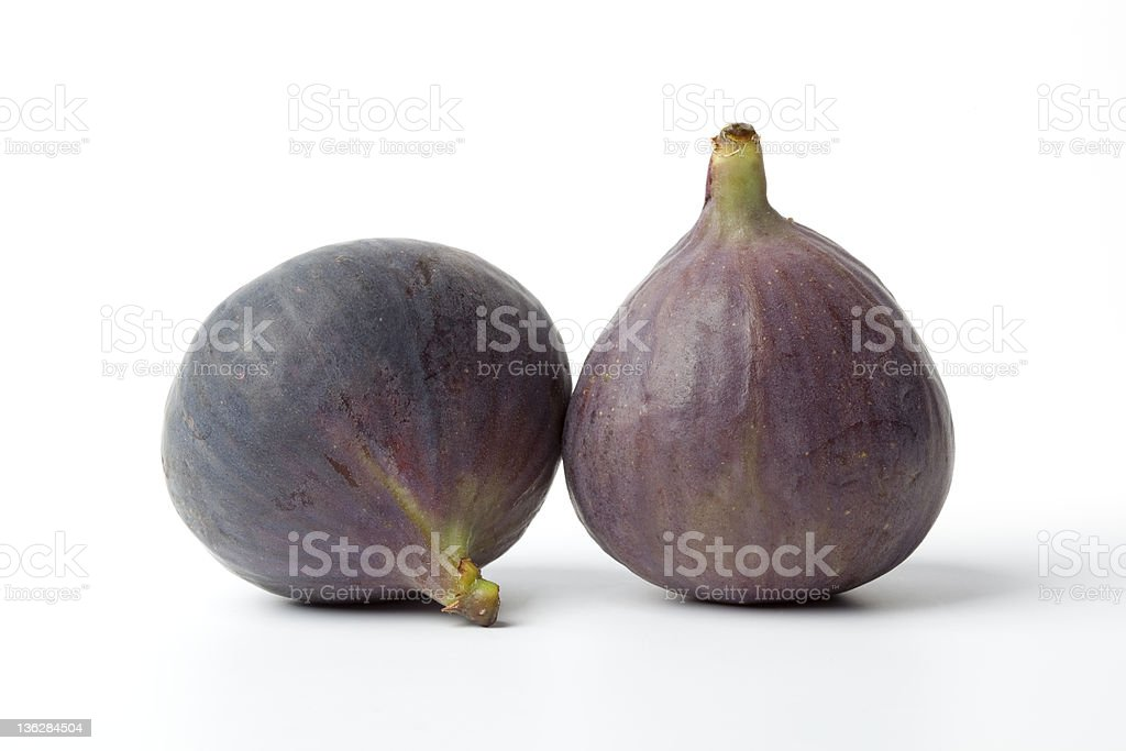 Two fresh figs on plain background royalty-free stock photo
