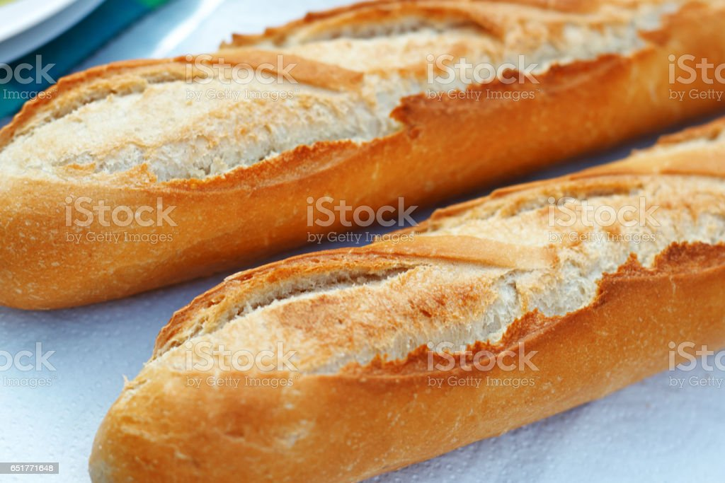Two fresh French baguettes close up stock photo