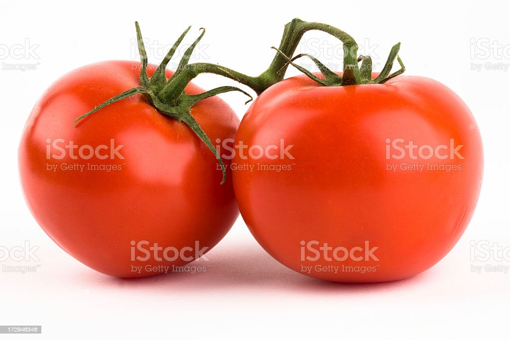 Two fresh ripe tomatoes isolated on white background stock photo