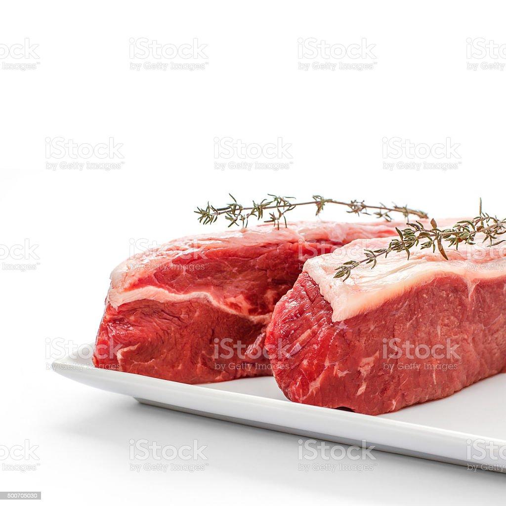 Two fresh rump steaks with thymine twig stock photo