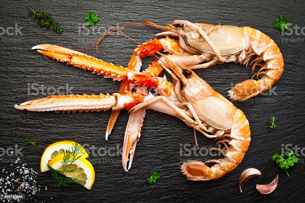 Two fresh shrimps on dark table stock photo