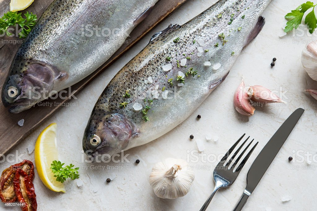 Two fresh trouts seasoned stock photo