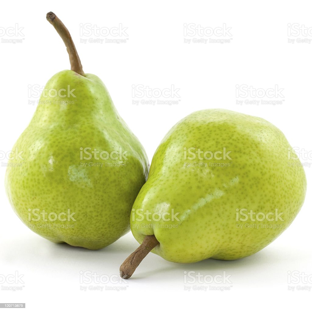 Two fresh yellowish pears with the stems attached stock photo