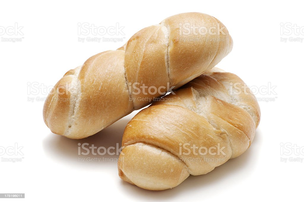 two freshly baled twist buns in front of white background royalty-free stock photo