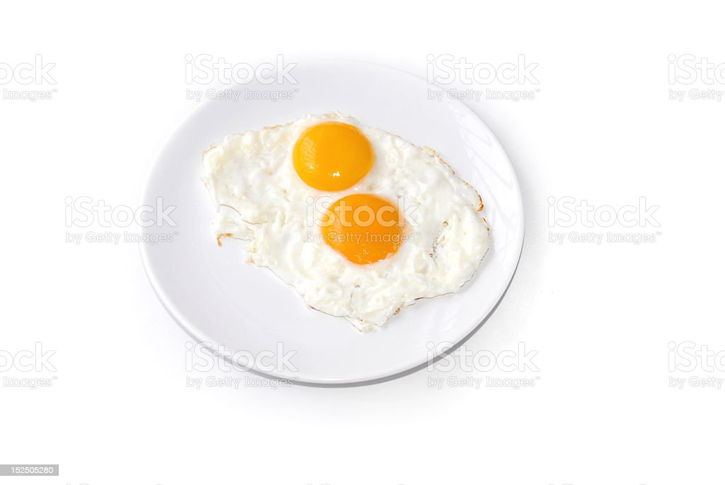 Two fried eggs on a white plate royalty-free stock photo