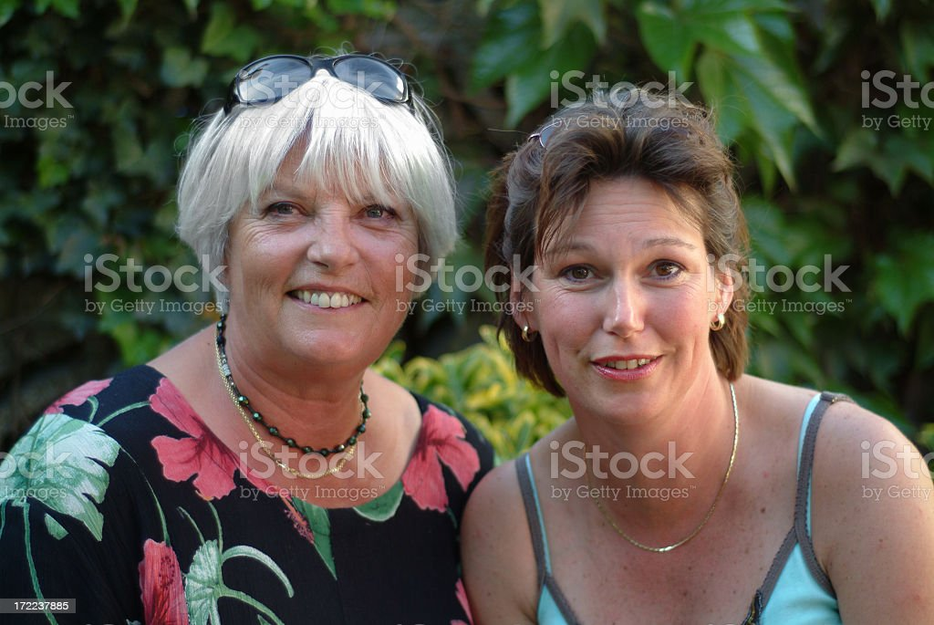Two friendly women looking at camera royalty-free stock photo