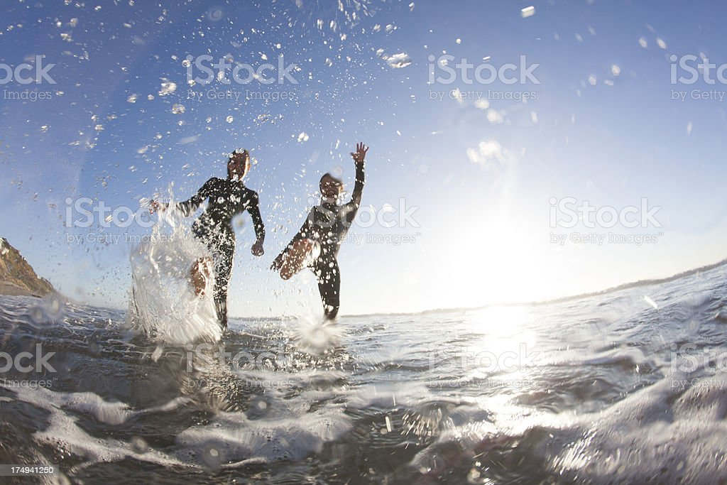 Two friends at the beach royalty-free stock photo