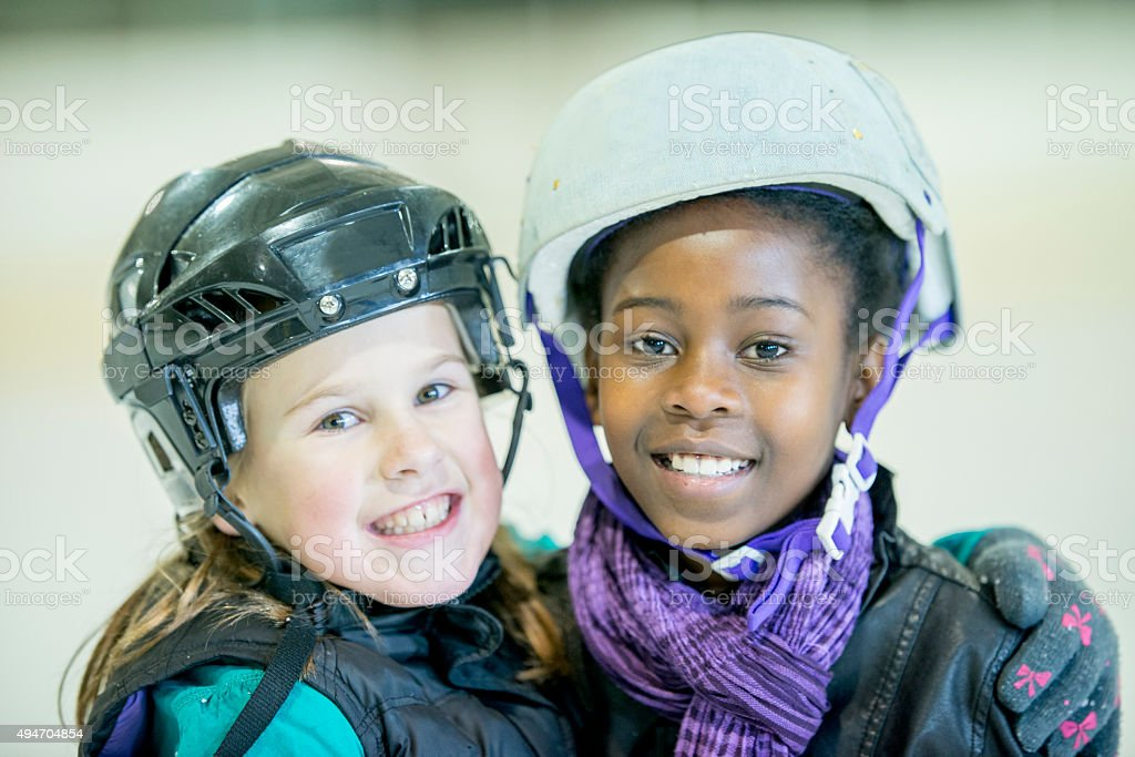 Two Friends at the Skating Rink Together stock photo