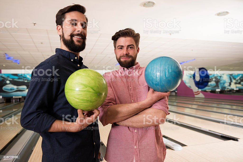 Two friends before bowling game stock photo