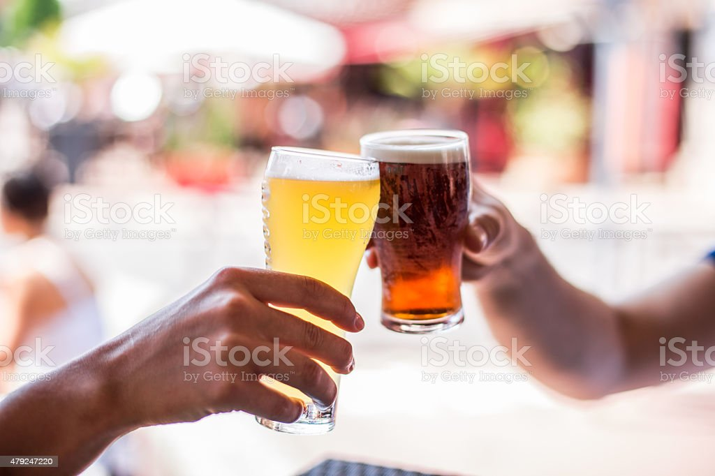 Two friends celebrating with beer. Cheers my friend! stock photo