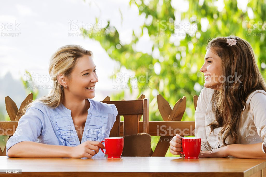 Two friends chatting with coffee royalty-free stock photo