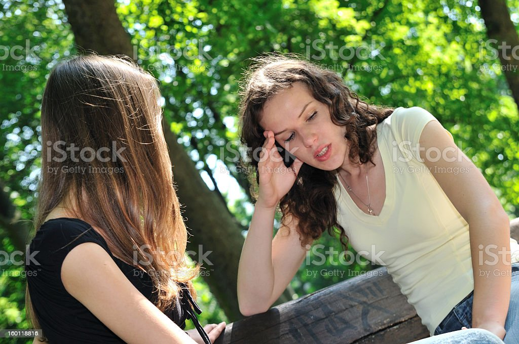 Two friends comforting one another royalty-free stock photo