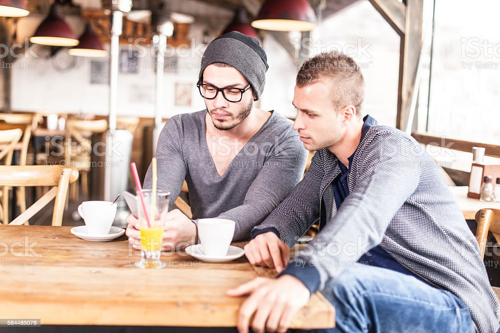 Two friends drinking coffee in a bar stock photo