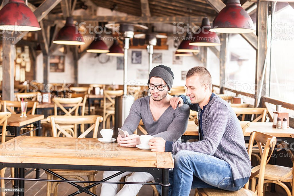 Two friends drinking coffee in a restaurant stock photo
