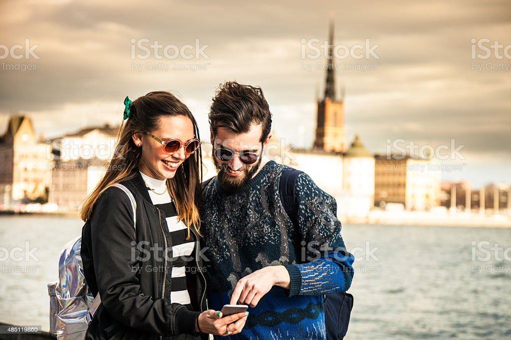 Two friends hanging out in the city stock photo