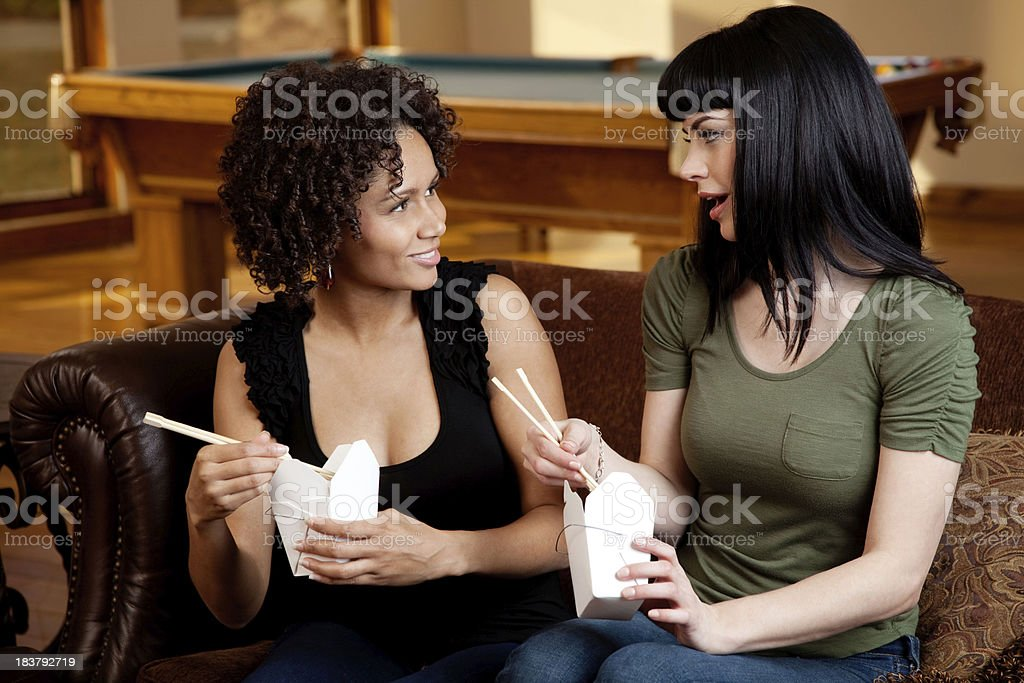 Two Friends Having a Chat & Chinese Take Out royalty-free stock photo