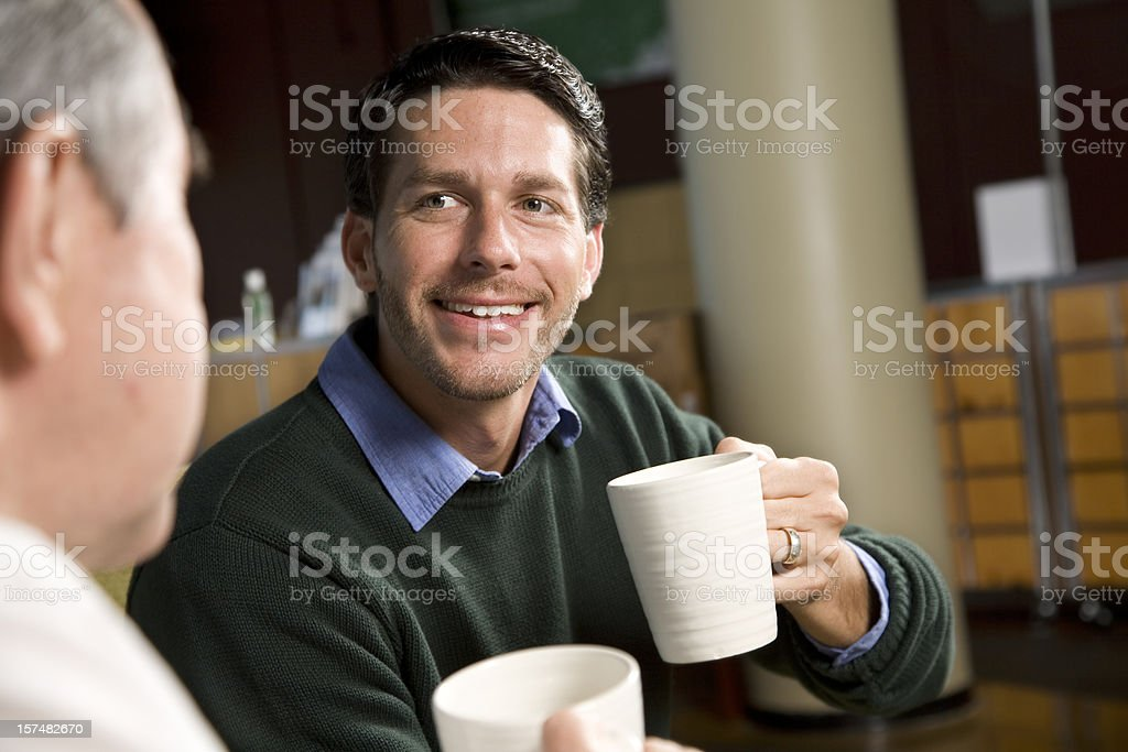 Two Friends Having Coffee Together, with Copy Space royalty-free stock photo