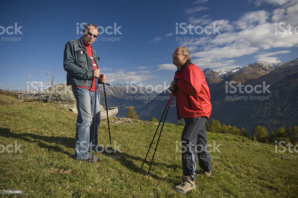 Two friends hiking royalty-free stock photo