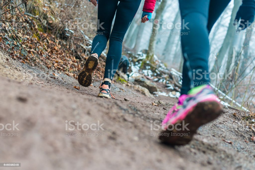 Two friends hiking together stock photo