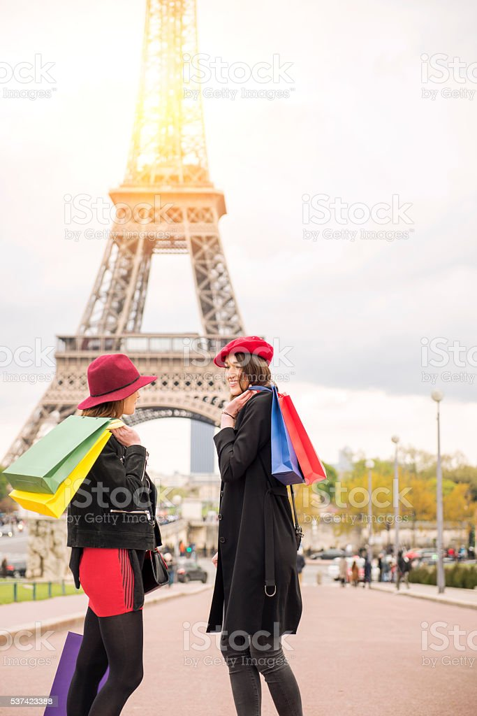 Two friends in Paris with shopping bags stock photo
