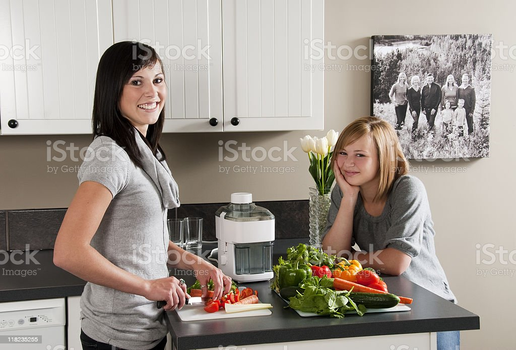 Two friends in the Kitchen royalty-free stock photo