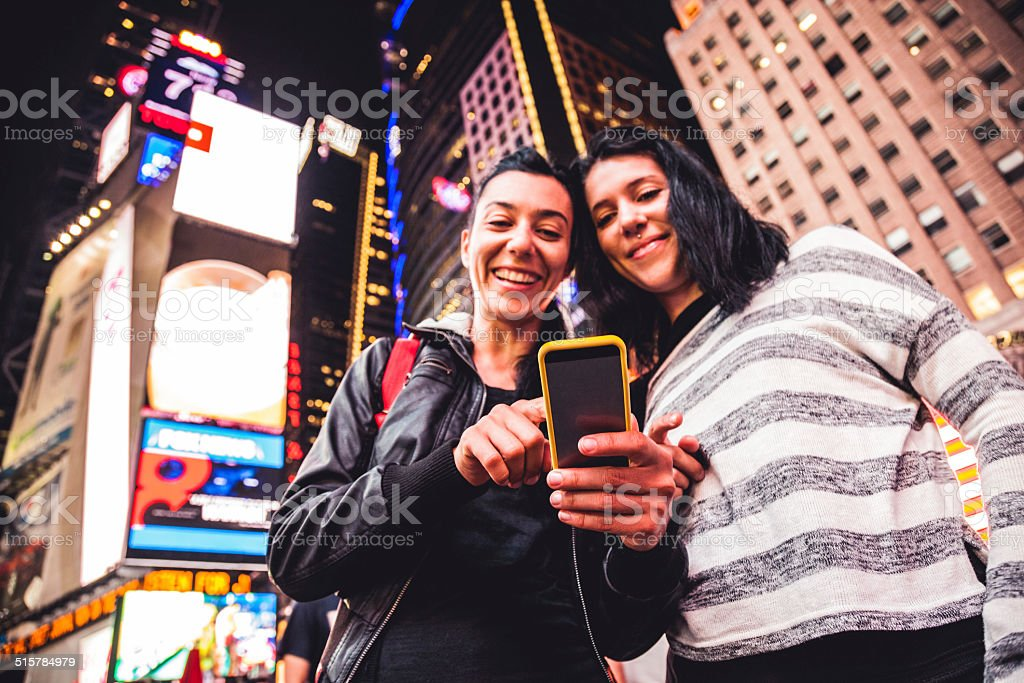 Two friends in Times Square stock photo