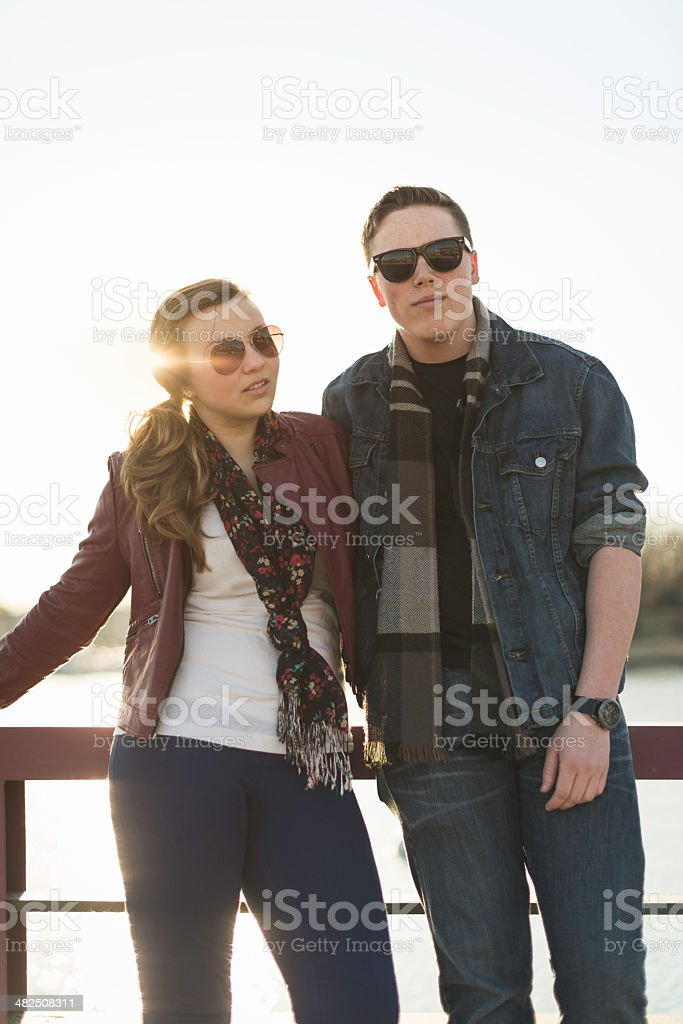 Two Friends Leaning Against a Railing stock photo