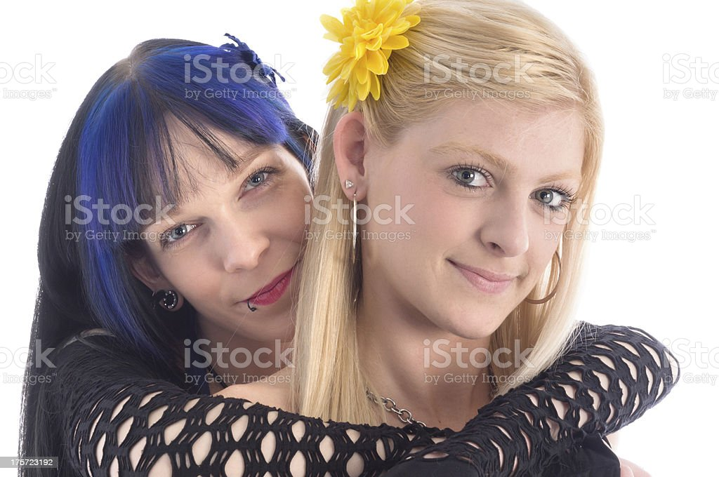 Two friends, one with arm around other. royalty-free stock photo