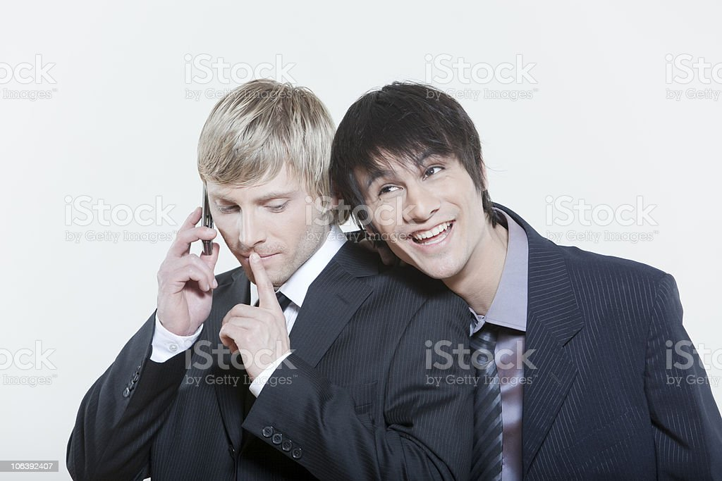 two friends phoning stock photo