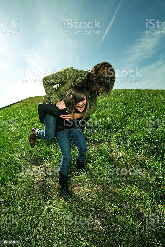 Two Friends Playing in Field royalty-free stock photo