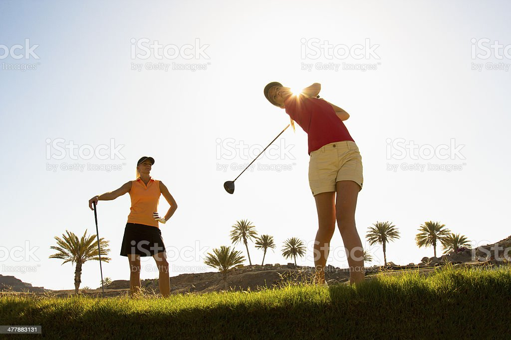 Two friends playing Sunday morning royalty-free stock photo