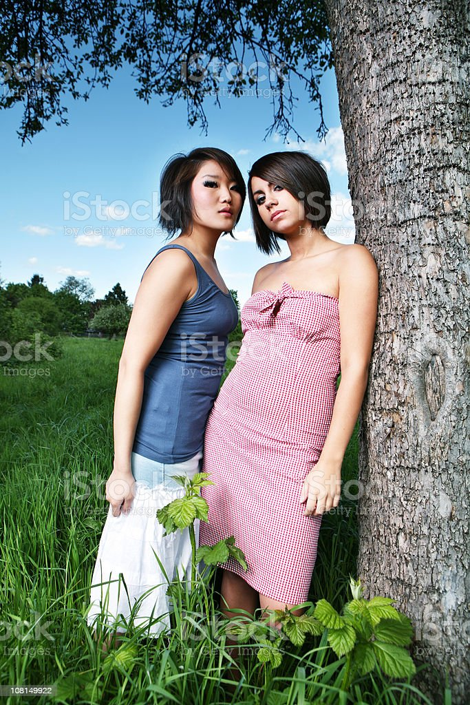 Two Friends Posing by a Tree royalty-free stock photo