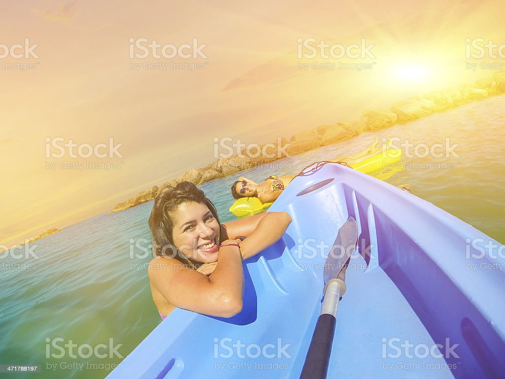 Two friends relaxing at sunset on the beach royalty-free stock photo