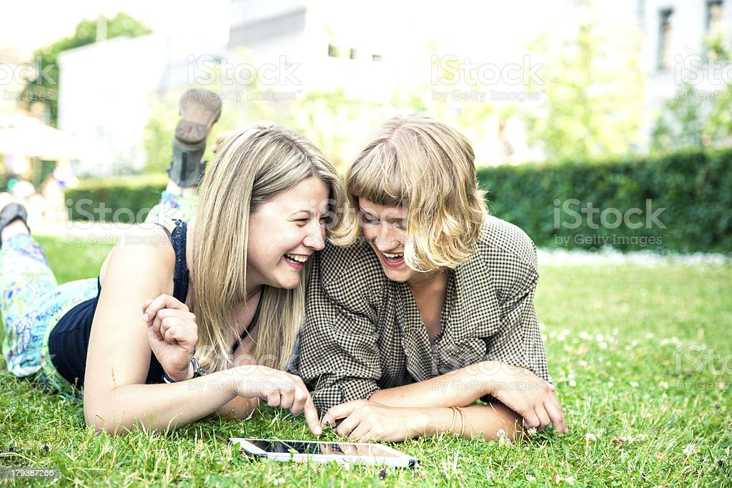 Two friends relaxing outdoors royalty-free stock photo