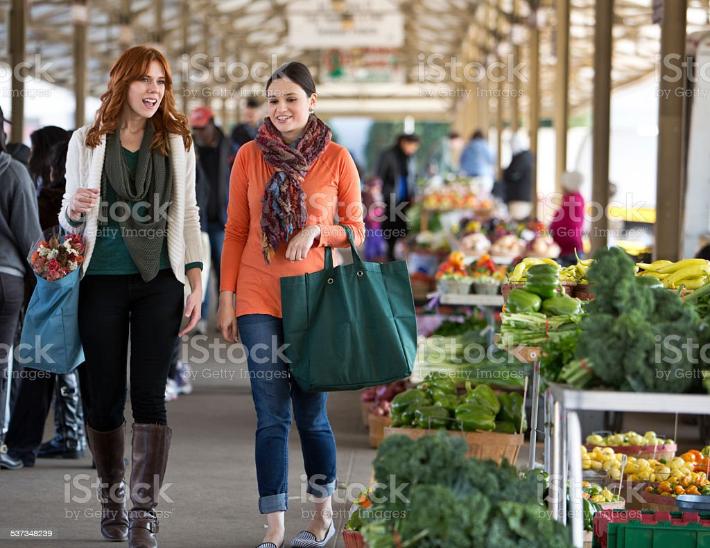 Two Friends Shopping at a Midwest Farmers Market. stock photo