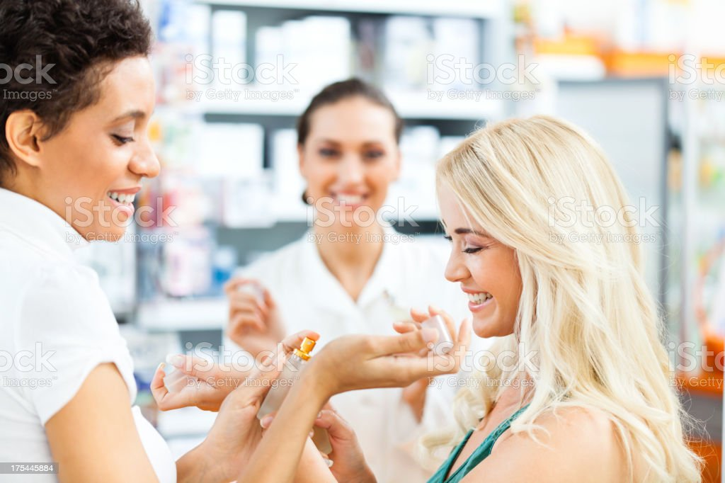 Two friends shopping for parfume royalty-free stock photo