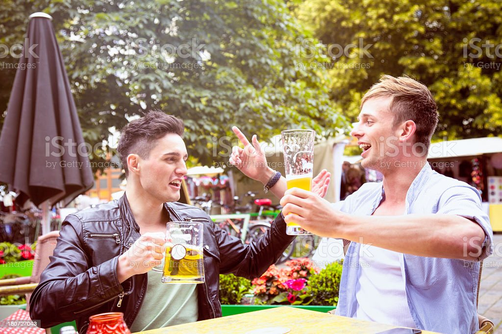 Two friends singing drinking songs with beer royalty-free stock photo