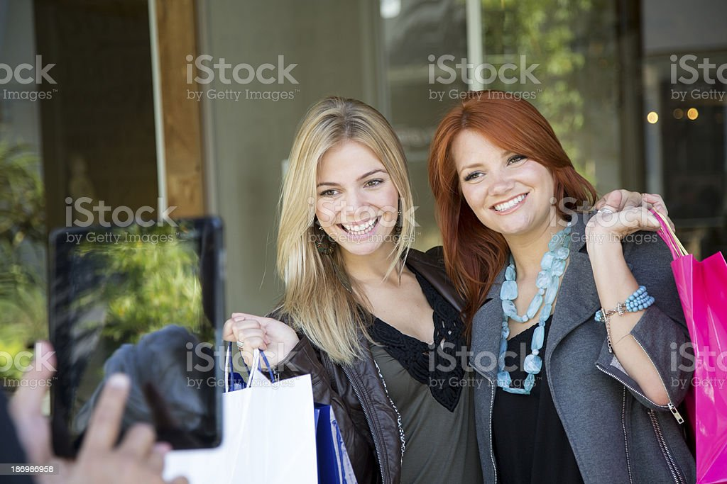 Two Friends Take Photo on Ipad Tablet royalty-free stock photo