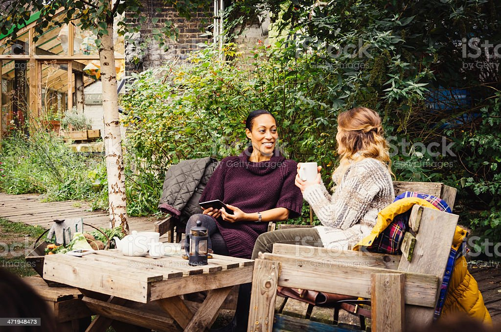 Two Friends Take Tea In The Garden stock photo