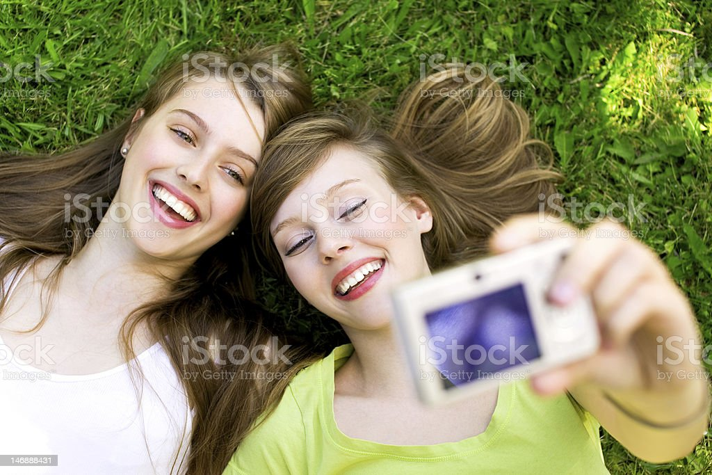 Two friends taking pictures royalty-free stock photo