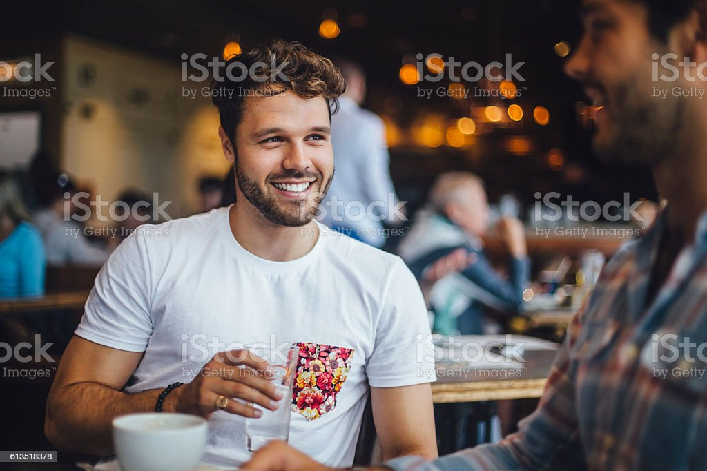 Two Friends Talking in a Cafe stock photo