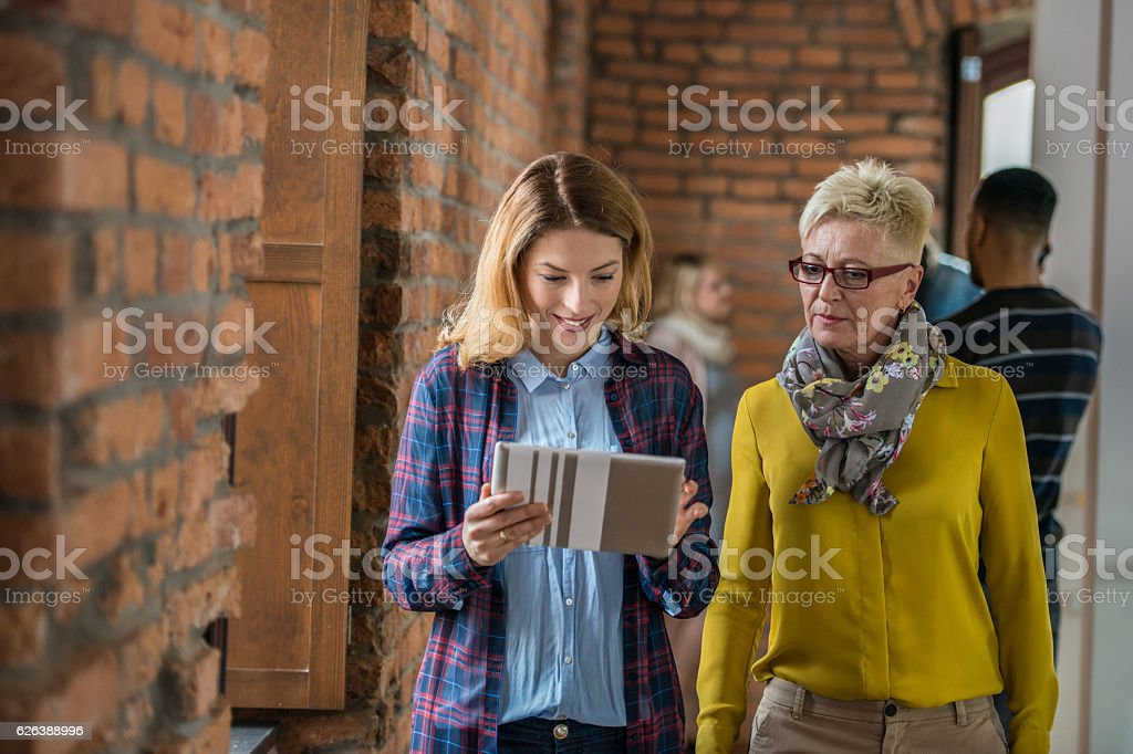 Two Friends Using Tablet Computer stock photo