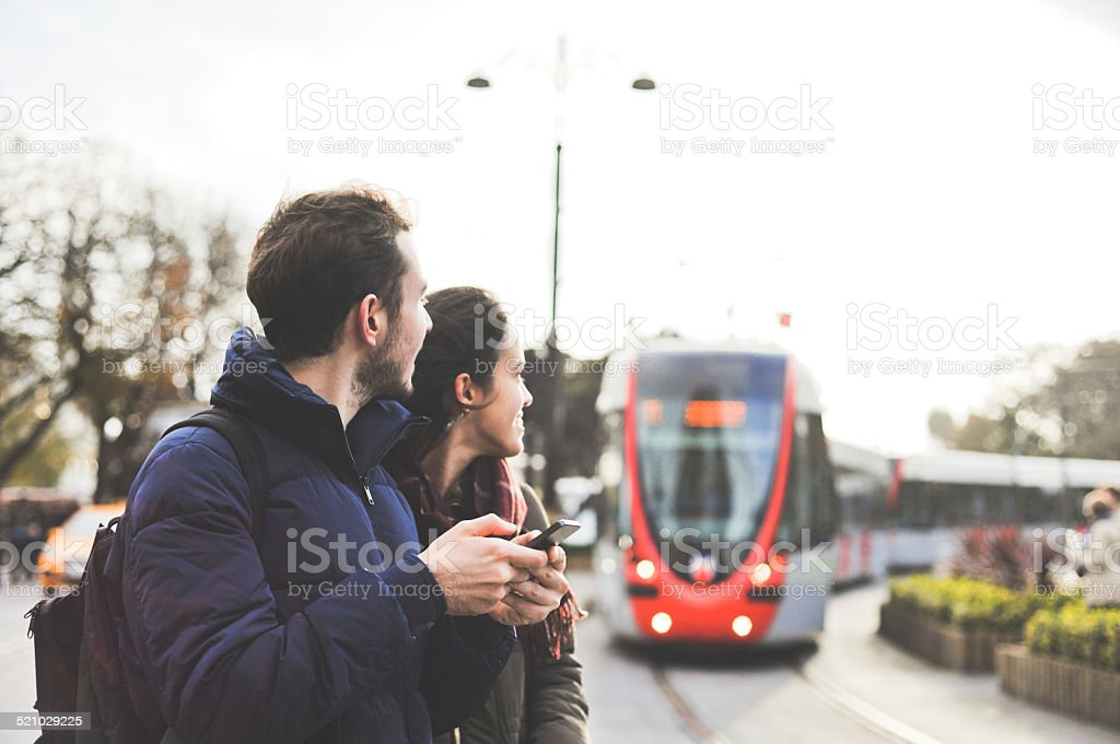 two friends waiting for the tram stock photo