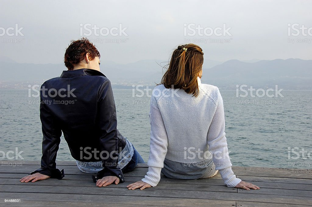two friends watching the sea royalty-free stock photo